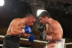 Boxers in the ring during fight for ranking points. Kyiv, Ukraine - December 24, 2016: An unidentified boxers in the ring during fight for ranking points in the Royalty Free Stock Images