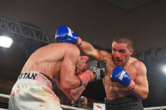Boxers in the ring during fight for ranking points. Kyiv, Ukraine - December 24, 2016: An unidentified boxers in the ring during fight for ranking points in the Stock Photography