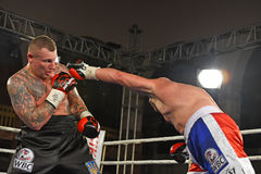 Boxers in the ring during fight for ranking points. Kyiv, Ukraine - December 24, 2016: An unidentified boxers in the ring during fight for ranking points in the Stock Photos