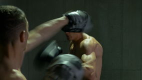 Boxers sparring and fighting at the gym. Two boxers sparring and fighting at the gym stock video footage