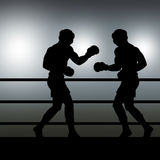 Boxers sparring. Illustration showing the silhouettes of two boxers sparring in a ring Royalty Free Stock Photos