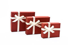 Boxes. Three red souvenir boxes white background isolate Stock Image