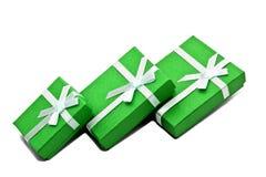 Boxes. Three green souvenir boxes white background isolate Stock Image