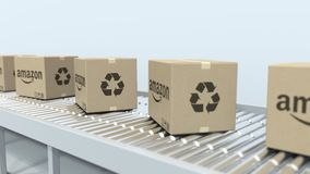 Boxes with AMAZON logo move on roller conveyor. Loopable editorial 3D animation