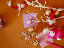 Boxes with balls, gifts, pink plastic car toy, Christmas decor on a bright background stock image