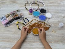 Boxes with beads, accessories for needlework. Royalty Free Stock Images
