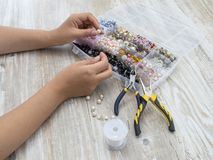 Boxes with beads, accessories for needlework. Royalty Free Stock Photos