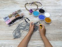 Boxes with beads, accessories for needlework. Stock Images