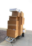 Boxes being delivered on trolley cart Royalty Free Stock Photo