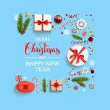 Boxes on blue background. Flat lay, top view Christmas composition with fir tree branches on light holiday background. Natural design elements. Festive Stock Photo