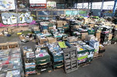 Boxes of books, waiting to be sorted at the Bookcycle UK warehouse Stock Photo