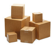 Boxes. Brown Cardboard Boxes in a Pile Isolated on a White Background Royalty Free Stock Photography