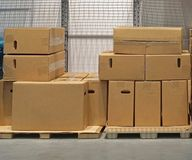 Boxes. Cardboard boxes at pallets in storage Royalty Free Stock Photography