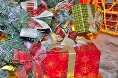 Boxes with Christmas Gifts Under Fir Tree Stock Photos