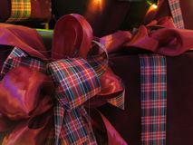 Boxes of Christmas presents wrapped with ribbons. Royalty Free Stock Photos