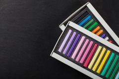 Boxes with colored crayons pastels Royalty Free Stock Photo