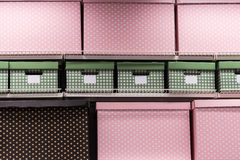 Boxes. Colored boxes on shelves Stock Images