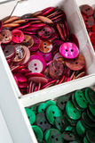 Boxes of colourful buttons Stock Photo