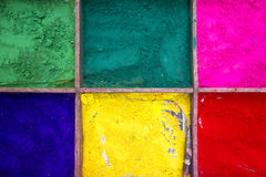Boxes with colourful powder paint Stock Image