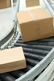 Boxes On Conveyor Belt Royalty Free Stock Photo