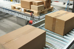 Boxes On Conveyor Belt Royalty Free Stock Photos
