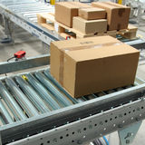 Boxes On Conveyor Belt Stock Photo