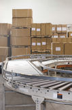 Boxes And Conveyor Belt In Warehouse Stock Image