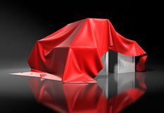 Boxes covered from above a red silk cloth. Black background Royalty Free Stock Photo