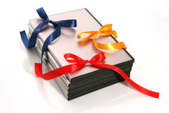 Boxes for DVD disks. Three packings for DVD disks decorated with multi-coloured tapes Stock Image