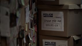 Boxes with evidential materials at police office, investigation process, case. Stock photo stock images
