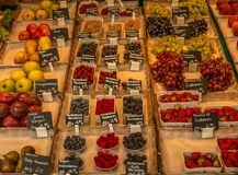 Boxes of fresh local berries and other fruits at a farmers` mark stock photography