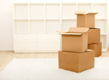Boxes in front of empty shelves - moving concept Stock Photo