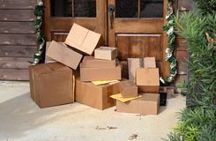 Boxes on front porch during holiday shopping season royalty free stock image