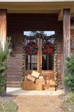 Boxes on front porch during holiday shopping season royalty free stock photo