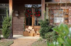Boxes on front porch during holiday shopping season stock images