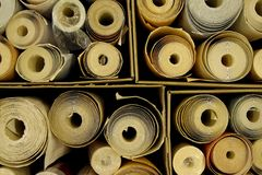 Boxes full of wallpaper rolls. Some open and some still wrapped in plastic Stock Photography
