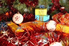 Boxes with gifts for Christmas and New Year are under the tree among the tinsel and Christmas toys. Stock Images