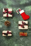 Boxes with gifts for Christmas and stocking with candy cane on a. Green background. Top view Royalty Free Stock Image