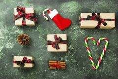 Boxes with gifts for Christmas and various attributes of holiday. On a green background. Top view Stock Photography