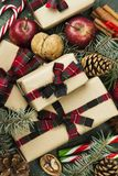 Boxes with gifts for Christmas and various attributes of holiday. On a green background. Top view Stock Images