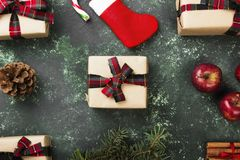 Boxes with gifts for Christmas and various attributes of holiday. On a green background. Top view Royalty Free Stock Images