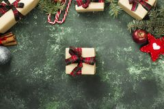 Boxes with gifts for Christmas and various attributes of holiday. On a green background. Top view Royalty Free Stock Photos