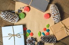 Boxes with gifts, cones, candies and marmalades, free space  on a wooden background.  Royalty Free Stock Photography