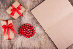 Boxes with gifts, coral beads and open diary with blank pages. Royalty Free Stock Image