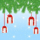 Boxes with gifts hang on the branches of tree Royalty Free Stock Photos