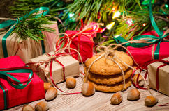 Boxes with gifts and hazelnuts under the Christmas tree Royalty Free Stock Image