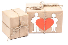 Boxes with gifts with heart, silhouette boy and girl. Royalty Free Stock Photo