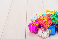Boxes with gifts on a light wooden boards Stock Photos
