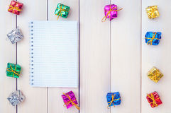 Boxes with gifts on a light wooden boards Royalty Free Stock Image