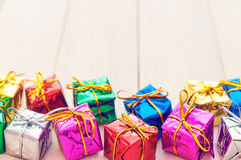 Boxes with gifts on a light wooden boards Stock Photo